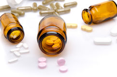 Pills spilling out of pill bottle Stock Photography