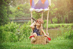 Pilot Girl in Hot Air Balloon Pretending to Travel Royalty Free Stock Photos