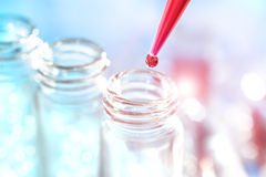 Pipette with drop of red sample Royalty Free Stock Photos