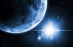 Planet earth with sunrise in the space Royalty Free Stock Photos