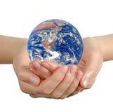 Planeten-Erde in der Hand Stockbilder