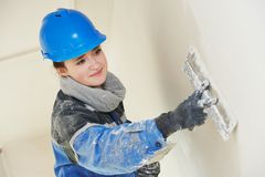 Plasterer at indoor wall work Royalty Free Stock Image
