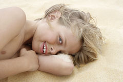 Playful Boy Lying On Sand Royalty Free Stock Images