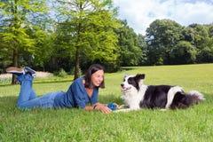 Playful dog and woman Stock Photo