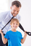Playful father and son. Stock Images