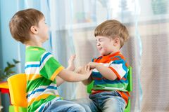 Playful kids friends at home Stock Images