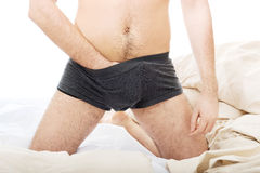 Playful male hand in panties. Royalty Free Stock Image