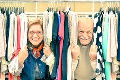 Playful senior couple at weakly flea market Stock Photos