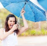 Playful woman in rain Stock Photography
