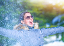 Playful woman on winter park Stock Photography