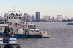 Police boats and a ferry on the Huangpu River Royalty Free Stock Image