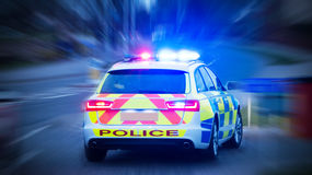 Police car with emergency lights on Stock Photos