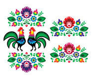 Polish ethnic floral embroidery with roosters - traditional folk pattern Stock Photo
