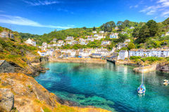 Polperro Cornwall England uk with clear blue and turquoise sea in vivid colour HDR like painting Royalty Free Stock Photography