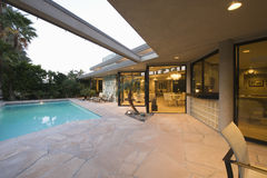 Pool And Modern Home Exterior Royalty Free Stock Photo