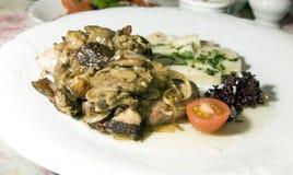 Pork sirloin stewed with local seasonal mushrooms  onions Polish Royalty Free Stock Image