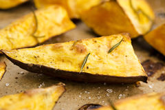 Portion of fresh baked sweet potato wedges Stock Photo