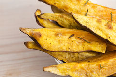 Portion of fresh baked sweet potato wedges Royalty Free Stock Photo
