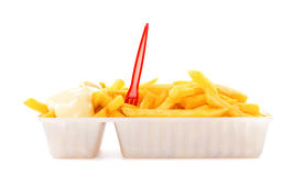 Portion of fries with mayonnaise and plastic fork Royalty Free Stock Photography