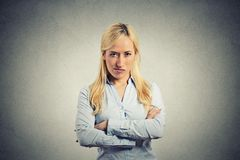 Portrait angry blonde woman on grey background Royalty Free Stock Image
