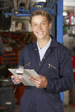 Portrait Of Apprentice Mechanic In Auto Repair Shop Royalty Free Stock Images