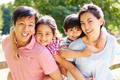 Portrait Of Asian Family Enjoying Walk In Summer Countryside Stock Images