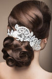 Portrait of a beautiful woman in the image of the bride with lace in her hair. Beauty face.Hairstyle back view Stock Images