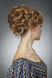 Portrait of a beautiful woman. Natural beauty. Updo. Rear view. Royalty Free Stock Photo