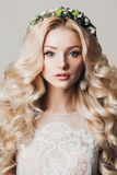 Portrait of a beautiful young blonde woman with long curly hair and eyes Stock Images