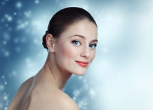 Portrait of a beautiful young girl model with clean skin and blu Stock Photo