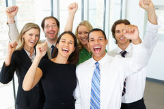 Portrait Of Business Team In Office Celebrating Stock Photos