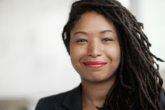 Portrait of smiling businesswoman with dreadlocks, head and shoulders Royalty Free Stock Photography