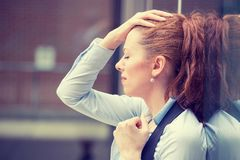 Portrait stressed sad young woman outdoors. Urban life style stress Stock Photography