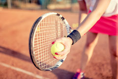 Portrait of tennis racquet with fitness girl. healthy training for sportswoman details Royalty Free Stock Images