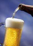 Pouring beer Stock Photography