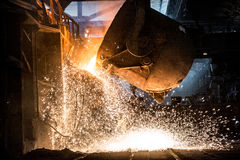 Pouring of liquid metal in open-hearth furnace Royalty Free Stock Image