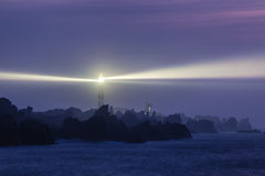 Powerful lighthouse at night Stock Image