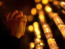 Praying in catholic church. Religion concept. Stock Photos