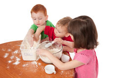 Preschooler kids making mess in kitchen Royalty Free Stock Images