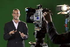 Presenter in studio with TV camera and Camera Operator Royalty Free Stock Photos