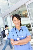 Pretty Asian School Nurse at Hospital Stock Photos