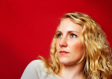 Pretty blond girl on red Royalty Free Stock Images