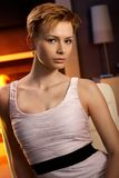 Pretty woman sitting in cosy room Stock Photography