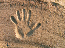 Print of a hand on sand. Royalty Free Stock Images
