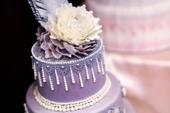 Purple wedding cake decorated with flowers Royalty Free Stock Photography