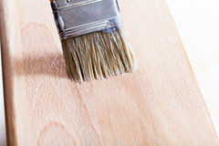 Putting varnish on beach wooden board Stock Photo