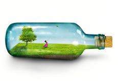 Ragazza in bottiglia Fotografia Stock
