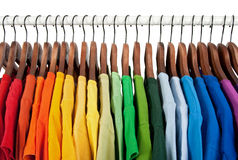 Rainbow colors, clothes on wooden hangers Royalty Free Stock Photos