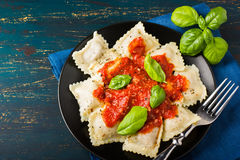 Ravioli with tomato sauce and basil Stock Photo
