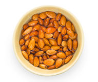 Raw almond nuts in bowl Stock Image